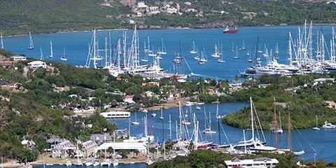 Body of water, Coastal and oceanic landforms, Coast, Watercraft, Boat, Water, Mast, Aerial photography, Sea, Marina,
