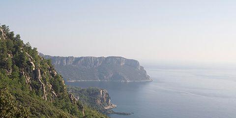 Body of water, Vegetation, Coastal and oceanic landforms, Natural landscape, Plant community, Coast, Terrain, Promontory, Mountain, Rock,