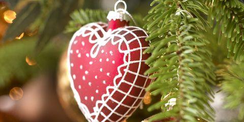 Event, Christmas decoration, Red, Christmas ornament, Holiday ornament, Christmas, Holiday, Ornament, Sphere, Interior design,