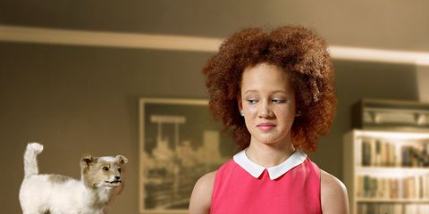 Jheri curl, Dress, Ringlet, Afro, One-piece garment, Day dress, Couch, Shelf, Red hair, Companion dog,