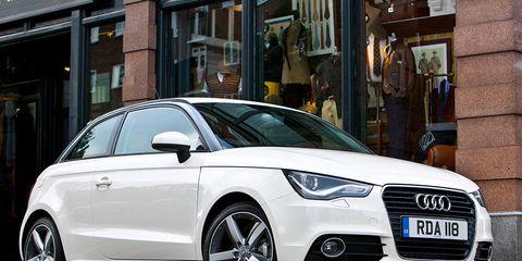 Tire, Wheel, Mode of transport, Automotive design, Automotive mirror, Daytime, Vehicle, Land vehicle, Vehicle registration plate, Transport,