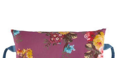 Textile, Cup, Cushion, Linens, Serveware, Coffee cup, Throw pillow, Creative arts, Floral design, Cup,