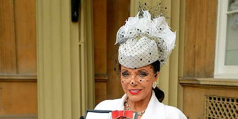 Headpiece, Uniform, Headgear, Hair accessory, Costume, Costume accessory, Street fashion, Costume design, Belt, Tradition,
