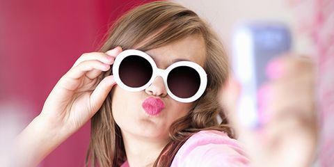 Eyewear, Glasses, Vision care, Finger, Lip, Sleeve, Hand, Sunglasses, Magenta, Pink,