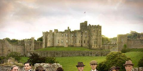 Footwear, Suit, Coat, Suit trousers, Building, Formal wear, People in nature, Blazer, Castle, Medieval architecture,