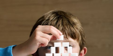 Finger, Wrist, Nail, Brown hair, Games, Play, Learning, Toy block, Square, Sweater,