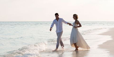 Clothing, Body of water, Fun, People on beach, Dress, Water, Shirt, Photograph, Coastal and oceanic landforms, Standing,