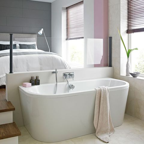 Use A Back To Wall Bath Create Luxurious Open Plan Look In Bedroom Section Off E At The End Of Your Bed With Half And Position