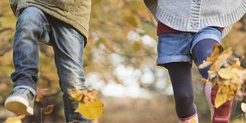 People in nature, Leaf, Autumn, Footwear, Yellow, Tree, Jeans, Shoe, Walking, Fun,