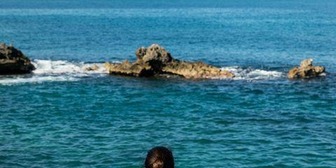 Coastal and oceanic landforms, Shoulder, Water, Elbow, Rock, Ocean, Azure, Coast, Waist, Sea,
