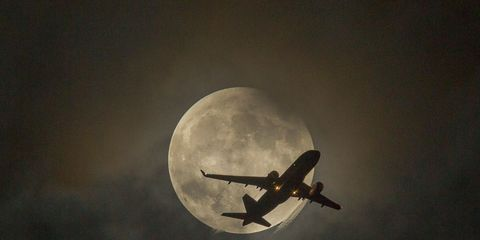 Airplane, Sky, Atmosphere, Event, Aircraft, Night, Astronomical object, Flight, Atmospheric phenomenon, Aerospace engineering,