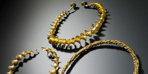 Yellow, Fashion accessory, Amber, Metal, Fashion, Jewellery, Natural material, Body jewelry, Tan, Circle,