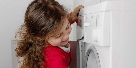 Standing, Jeans, Denim, Refrigerator, Machine, Major appliance, Brown hair, Kitchen appliance, Child model,
