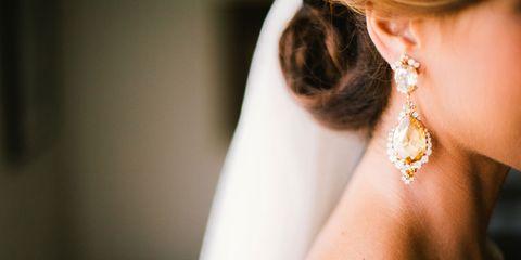 Ear, Earrings, Hairstyle, Skin, Jewellery, Bridal accessory, Fashion accessory, Bridal veil, Veil, Body jewelry,