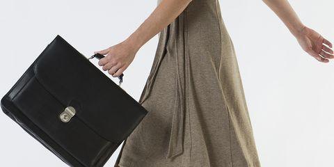 Brown, Bag, Joint, Dress, Human leg, High heels, Waist, Fashion, Tan, Luggage and bags,