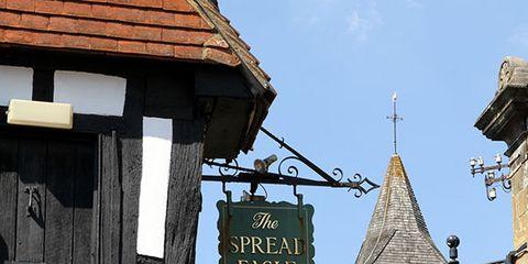 Wood, Property, Real estate, Landmark, Roof, Brick, Signage, Brickwork, Door, Medieval architecture,