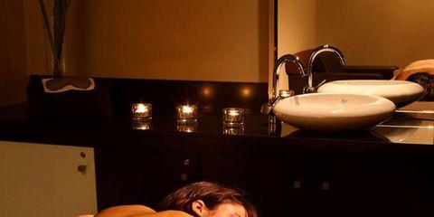 Lighting, Comfort, Room, Human leg, Wrist, Amber, Dishware, Barechested, Back, Muscle,