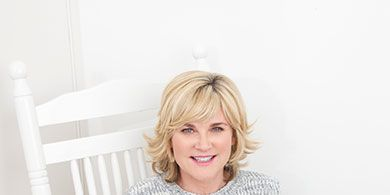 Mouth, Human body, Comfort, Sweater, Sitting, Cup, Blond, Layered hair, Coffee cup, Bob cut,