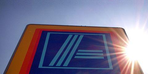 Daytime, Sun, Sign, Signage, Lens flare, Sunlight, Electric blue, Rectangle, Gas, Majorelle blue,