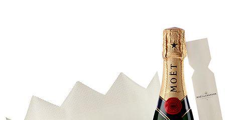 Bottle, Liquid, Bottle cap, Glass bottle, Label, Beige, Brand, Packaging and labeling, Distilled beverage, Cork,