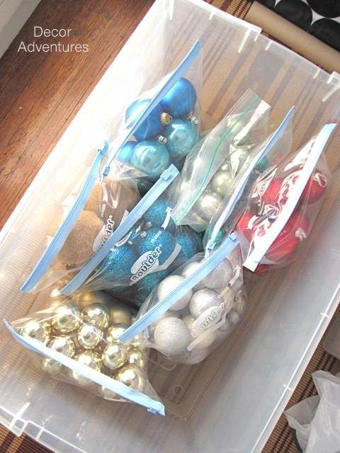 If you want to keep all your ornaments in the same container, but sorted by colour, use clear gallon bags from your kitchen. Then next year, it'll be super ...