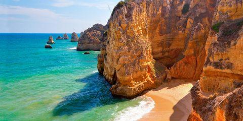 Body of water, Coastal and oceanic landforms, Coast, Shore, Water, Rock, Sand, Ocean, Beach, Outcrop,
