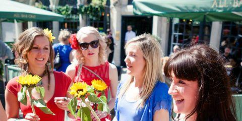 Eyewear, Smile, Yellow, Bouquet, Happy, Flower, Facial expression, Sunglasses, Dress, Cut flowers,