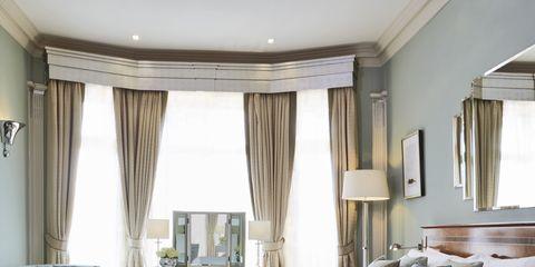 Interior design, Room, Floor, Wood, Bed, Property, Flooring, Architecture, Textile, Furniture,