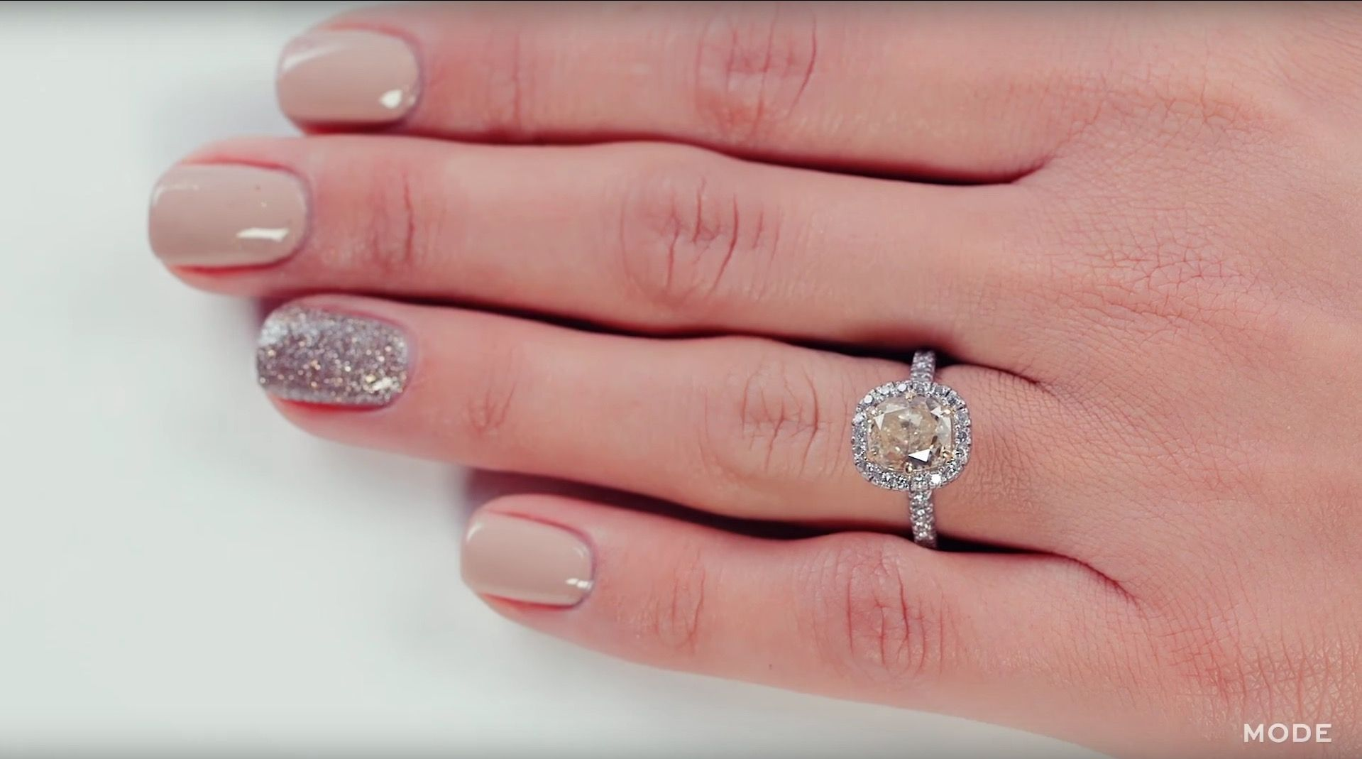 Women try on 100 years of engagement rings