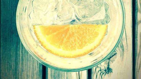 Lemon, Citrus, Yellow, Gin and tonic, Lime, Lemonade, Citron, Lemon-lime, Meyer lemon, Glass,