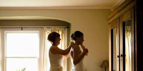 Flooring, Floor, Dress, Wood, Room, Interior design, Bridal clothing, Wood flooring, Gown, Formal wear,
