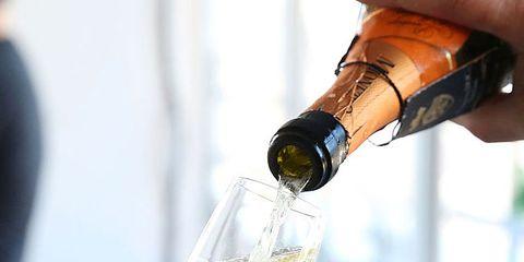Finger, Bottle, Glass bottle, Fluid, Drink, Alcohol, Drinkware, Alcoholic beverage, Glass, Nail,