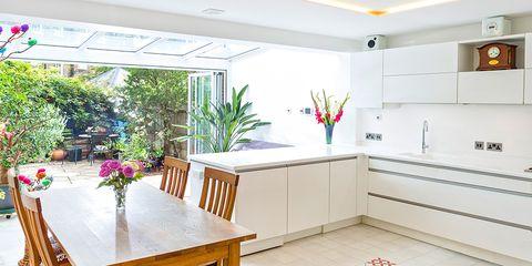 Floor, Interior design, Room, Flooring, Table, Ceiling, Interior design, Light fixture, Orange, Tile,