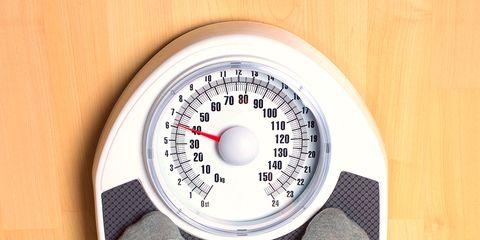 Human leg, Sock, Hardwood, Measuring instrument, Circle, Gauge, Number, Wood stain, Tights, Silver,
