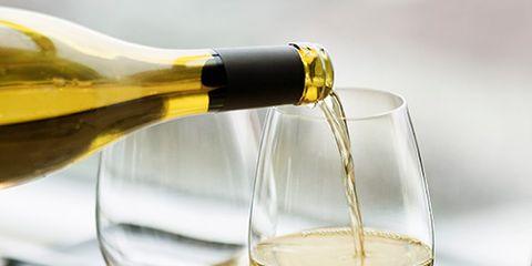 Fluid, Drinkware, Glass, Stemware, Yellow, Drink, Wine glass, Liquid, Barware, Alcoholic beverage,