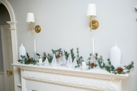 i started by placing faux pine garlands on my fireplace mantel then placed some glass ornaments throughout and even hung a few throughout the garland