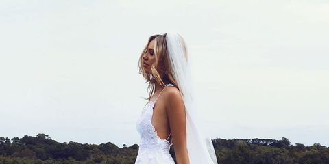 Clothing, Blue, Hairstyle, Dress, Shoulder, Photograph, Swimming pool, Wedding dress, Happy, Aqua,