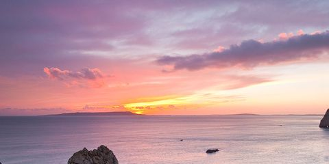 Body of water, Coastal and oceanic landforms, Coast, Cloud, Water, Natural landscape, Sunset, Rock, Dusk, Shore,