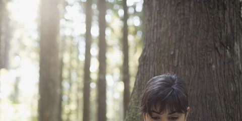 Mammal, Sitting, People in nature, Forest, Trunk, Woodland, Old-growth forest, Bangs, Reading, Portrait photography,