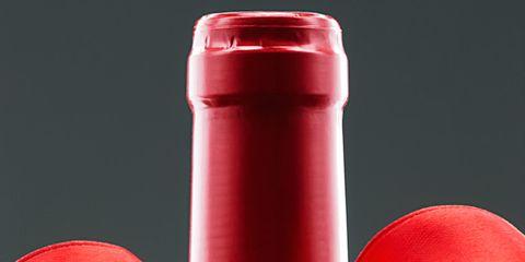 Red, Ribbon, Water bottle, Bottle, Material property, Drinkware, Tableware, Plastic, Wheel,