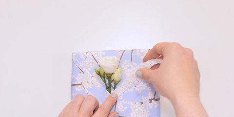 Finger, Nail, Wrist, Paper, Paint, Creative arts, Paper product, Coquelicot, Gesture, Annual plant,