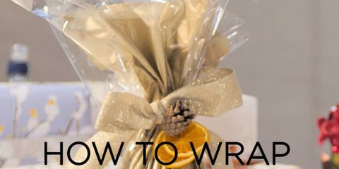 Yellow, Font, Party supply, Ribbon, Present, Knot, Citrus, Orange, Cut flowers, Fruit,