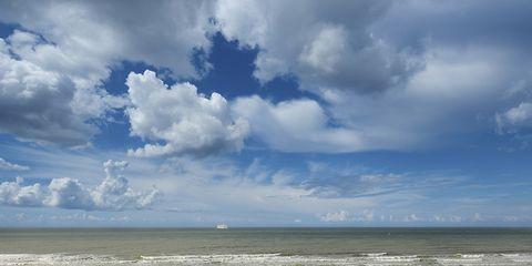Sky, Cloud, Comfort, Sitting, Horizon, People in nature, Bench, Outdoor furniture, Ocean, Vacation,