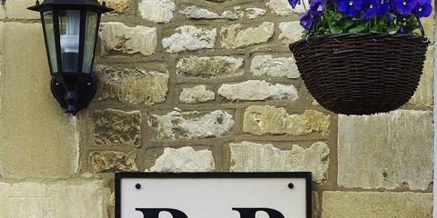 Wall, Flowerpot, Font, Light fixture, Lavender, Number, Interior design, Lantern, Address sign, House numbering,