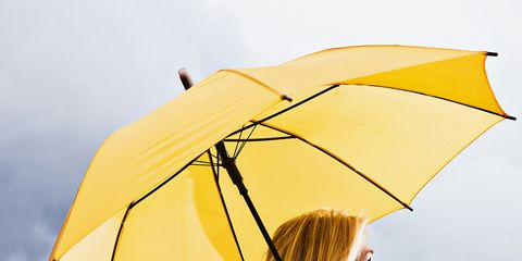 Yellow, Hairstyle, Umbrella, Photograph, Winter, Beauty, Street fashion, Travel, Electric blue, Scarf,