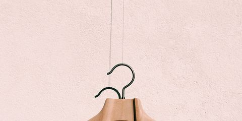 Clothes hanger, Wood, Hand, Finger, Home accessories, Logo,