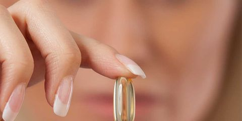 Finger, Skin, Nail, Amber, Thumb, Photography, Close-up, Body jewelry, Nail care, Flesh,