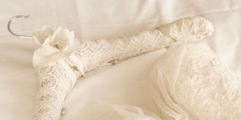 White, Embellishment, Wedding dress, Lace, Ivory, Bridal accessory, Natural material, Knot, Bridal shoe, Fashion design,