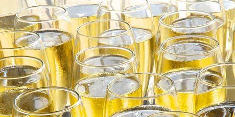 Yellow, Glass, Drinkware, Liquid, Barware, Transparent material, Wind instrument, Distilled beverage, Schnapps,