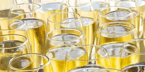 Yellow, Glass, Drinkware, Pattern, Wind instrument, Transparent material, Barware, Kitchen utensil, Distilled beverage,
